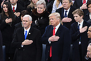 President Donald Trump and Vice President Mike Pence stand for the national anthem after taking the oath of office as the 45th President during the Inaugural Ceremony on Capitol Hill January 20, 2017 in Washington, DC.
