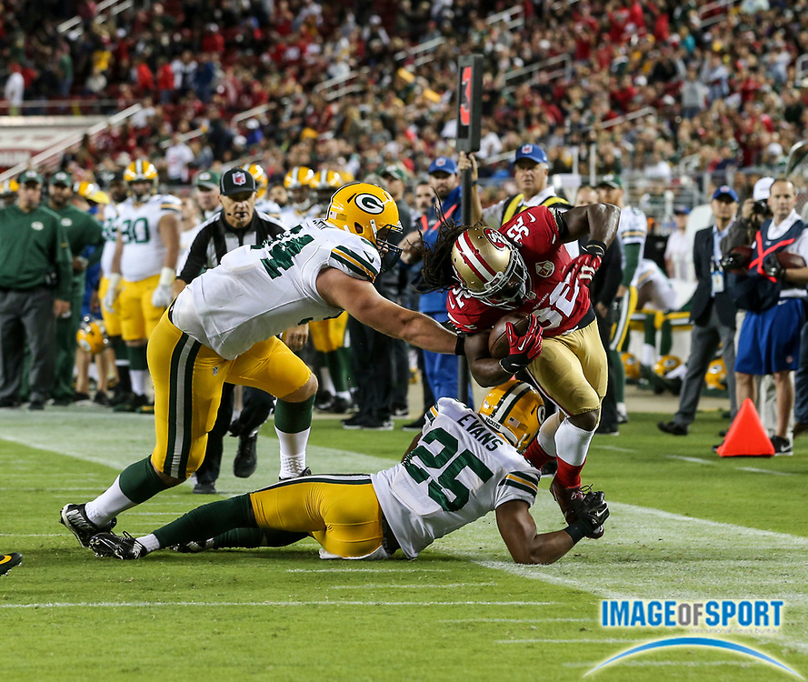 Aug 26, 2016, Santa Clara, CA, USA; San Francisco 49ers running back DuJuan Harris (32) is forced out of bounds by Green Bay Packers safety Marwin Evans (25) in a preseason NFL game at Levi's Stadium. Green Bay beat San Francisco 21-10.