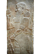 Stone relief sculptured panel of a man holding poppy seed pods. Facade N. Inv AO 19870 from Dur Sharrukin the palace of Assyrian king Sargon II at Khorsabad, 713-706 BC.  Louvre Museum Room 4 , Paris