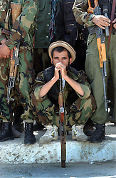 KABUL,AFGHANISTAN - SEPT. 9: An Afghan police officer watches a ceremony in Kabul Sports Stadium September 9, 2002  to comemerate the anniversary of the death of Ahmad Shah Massoud in Kabul, Afghanistan. (Photo by Ami Vitale/Getty Images)