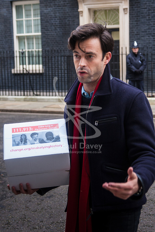 """Downing Street, London, January 7th 2015. TV star 2015-01-07 TV star Jolyon Rubinstein delivers a """"Make Lying in Parliament History"""" petition with 111,913 signatures to 10 Downing Street. The petition aims """"to start a debate about the importance of the truth in politics"""" and comes off the back of his satirical TV show The Revolution Will be Televised which has been """" highlighting the corruption, greed and hypocrisy in our system"""" and wants to make lying in Parliament a criminal offence. PICTURED: Jolyon Rubinstein outside 10 Downing Street."""