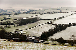 © Licensed to London News Pictures. 06/01/2021. Builth Wells, Powys, Wales, UK. A wintry landscape after fresh snowfall on the Mynydd Epynt range near Builth Wells in Powys, Wales, UK. Photo credit: Graham M. Lawrence/LNP