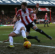Andrew Surman tackling Jonathan Douglas during the Sky Bet Championship match between Brentford and Bournemouth at Griffin Park, London, England on 21 February 2015. Photo by Matthew Redman.