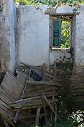 Wooden beams and timbers in derelict abandoned house ruin in ancient village of Old Perithia - Palea Perithea, Corfu, , Greece