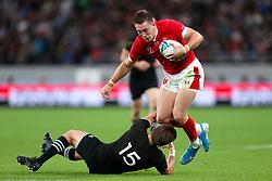 New Zealand's Beauden Barrett (left) challenges Wales' Josh Adams during the 2019 Rugby World Cup bronze final match at Tokyo Stadium.