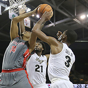 ORLANDO, FL - NOVEMBER 15:  A.J. Davis #3 and Chad Brown #21 of the UCF Knights block a shot attempt by Brandon Miller #14 of the Gardner Webb Runnin Bulldogs during a NCAA basketball game at the CFE Arena on November 15, 2017 in Orlando, Florida. (Photo by Alex Menendez/Getty Images) *** Local Caption *** A.J. Davis; Chad Brown; Brandon Miller