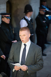 © London News Pictures. 26/02/2014. London, UK.  A Police family liaison officer Pete Sparks reading a family statement to the media outsde  the Old Bailey in London where Michael Adebolajo and Michael Adebowale were sentenced for the murder of Fusilier Lee Rigby who was attacked near Woolwich Barracks in south-east London on May 22, 2013. Photo credit: Ben Cawthra/LNP