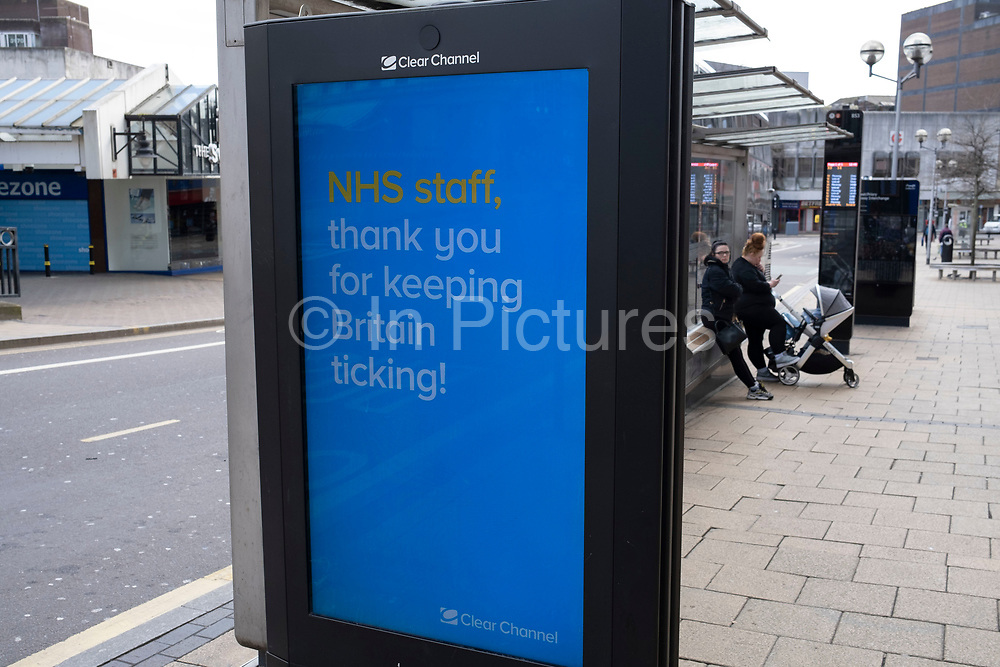 HM Government, and NHS advertising boards thanking NHS staff in Birmingham city centre is virtually deserted due to the Coronavirus outbreak on 30th March 2020 in Birmingham, England, United Kingdom. Following government advice most people are staying at home leaving the streets quiet, empty and eerie. Coronavirus or Covid-19 is a new respiratory illness that has not previously been seen in humans. While much or Europe has been placed into lockdown, the UK government has announced more stringent rules as part of their long term strategy, and in particular social distancing.