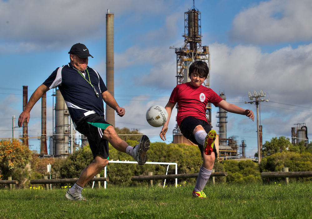Simon Dew & son Lucas who suffers from asthma which is made worse in industrial locations. In the background is the Altona Oil Refinery. Pic By Craig Sillitoe CSZ / The Sunday Age.21/07/2012 melbourne photographers, commercial photographers, industrial photographers, corporate photographer, architectural photographers, This photograph can be used for non commercial uses with attribution. Credit: Craig Sillitoe Photography / http://www.csillitoe.com<br /> <br /> It is protected under the Creative Commons Attribution-NonCommercial-ShareAlike 4.0 International License. To view a copy of this license, visit http://creativecommons.org/licenses/by-nc-sa/4.0/.