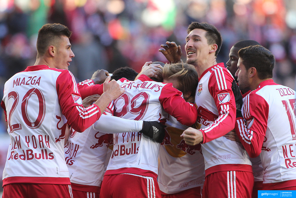 Sacha Kljestan, New York Red Bulls, salutes the fans as the team celebrate a goal from Bradley Wright-Phillips during the New York Red Bulls Vs D.C. United Major League Soccer regular season match at Red Bull Arena, Harrison, New Jersey. USA. 22nd March 2015. Photo Tim Clayton