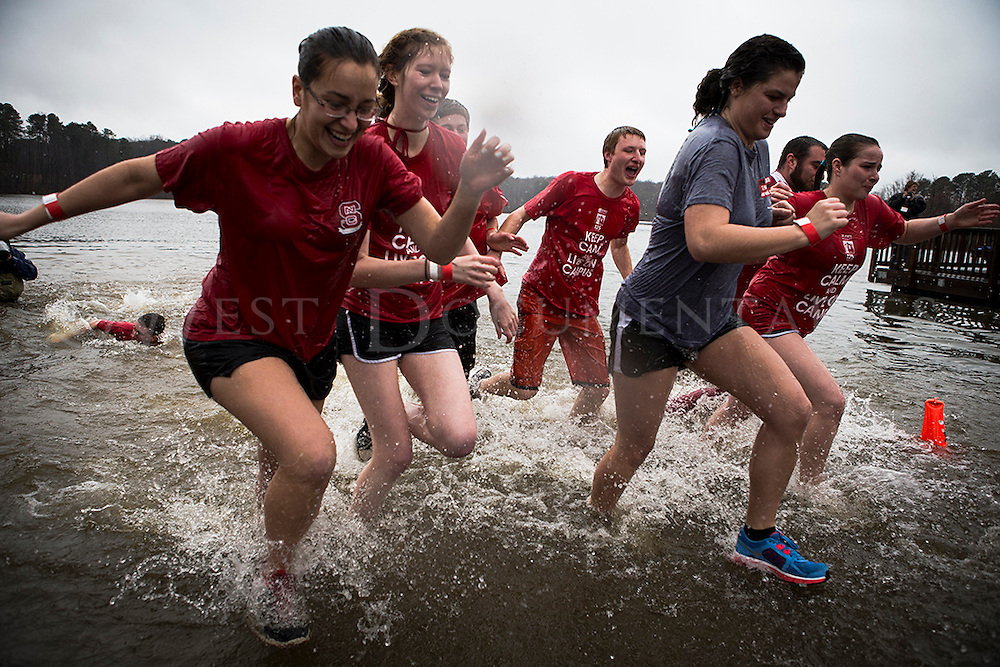 Participants of the 2013 Polar Plunge, which was held at Lake Raleigh, Centennial Campus, NC State University, rush out of the cold waters on February 23, 2012. The event helped raise money and awareness for the Special Olympics.