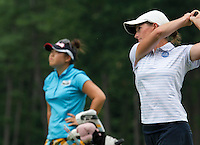 Christine Song watches as Jean Reynolds tees off during Saturday's round of the Symetra LPGA Tour at Beaver Meadow Golf Course.  (Karen Bobotas/for the Concord Monitor)