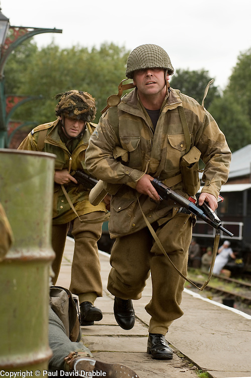 Reenactors portraying British paratroops of the 6th airborne division take part in a battle reenactment at Elsecar Heritage centre during the Elsecar 1940s Weekend <br /> 4 September 2010<br /> Images © Paul David Drabble
