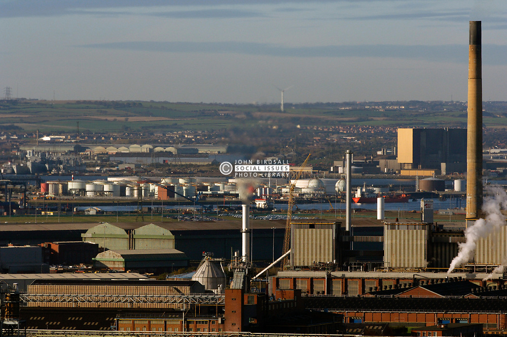 Industrial area Teesside; showing oil refinery; docks; containers & chemical plants, Hartlepool nuclear power plant is in the background on the right