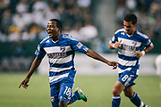 FC Dallas midfielder Marvin Chavez celebrates after scoring as his teammate Bruno Guarda follows during the first half of an MLS soccer match against the Los Angeles Galaxy, Saturday, Aug. 6, 2011, in Carson, Calif. (AP Photo/Bret Hartman)
