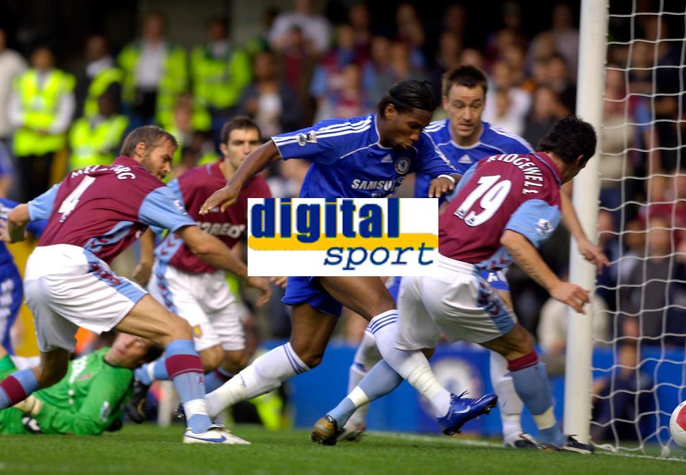 Photo: Daniel Hambury.<br /> Chelsea v Aston Villa. The Barclays Premiership. 30/09/2006.<br /> Chelsea's Didier Drogba scores to make it 1-0.