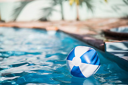 Inflatable ball drifting in swimming pool, Mauritius