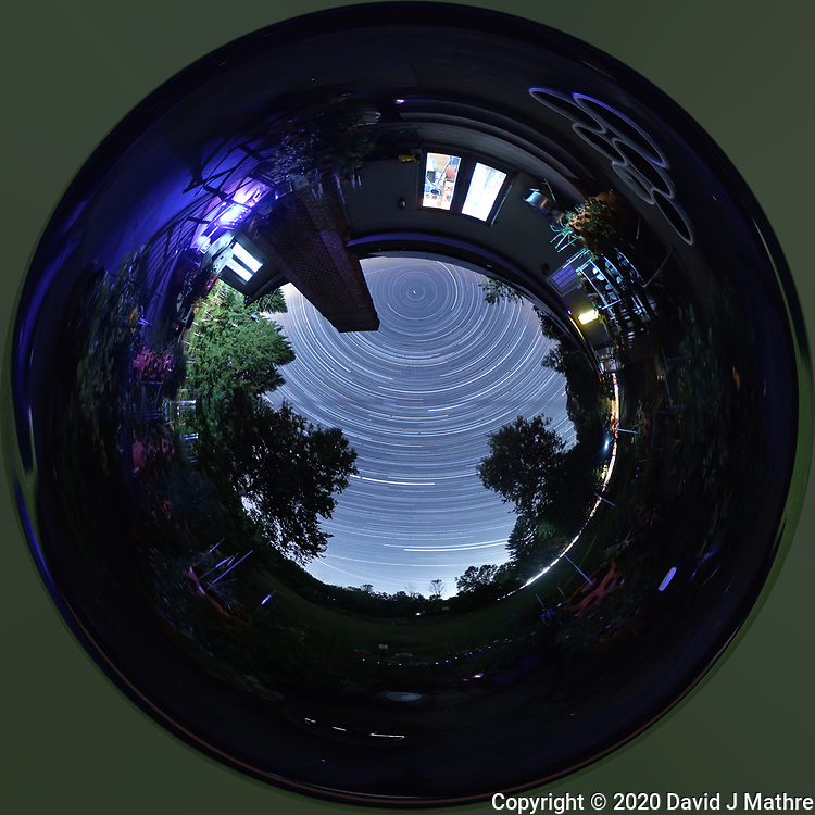 Backyard Late Summer Nighttime Sky Over New Jersey. Inverse Little Planet (Tunnel View) 360 degree Panorama. Composite of 360 (jpg) images taken with a Ricoh Theta Z1 360 camera (ISO 400, 2.6 mm, f/2.1, 60 sec). Star Trail composite and Inverse Little Planet view created with PhotoShop CC (scripts, statistics, maximum), (image size 1:1,  filter, distort, polar coordinates).