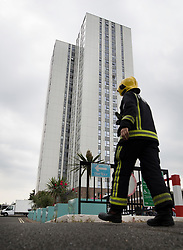© Licensed to London News Pictures. 27/06/2017. London, UK. A firewoman walks to Bray tower block on the Chalcots Estate in Camden after a smell fo gas was reported. More than 700 flats in tower blocks on an estate in the Swiss Cottage area of north-west London are being evacuated because of fire safety concerns after the Grenfell Tower fire of on June 14. Photo credit: Peter Macdiarmid/LNP