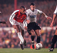 Thierry Henry (Arsenal) and Lilian Martin (Derby). Arsenal 0:0 Derby County. F.A. Premiership, 11/11/2000. Credit: Colorsport / Stuart MacFarlane.