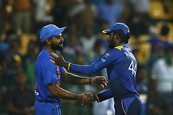 September 6, 2017 - Colombo, Sri Lanka - Indian cricket captain Virat Kohli (L) and Sri Lankan cricket captain Upul Tharanga shake hands after India defeated Sri Lanka during the 1st and only T-20 cricket match between Sri Lanka and India at R Premadasa International cricket stadium in Colombo, Sri Lanka on Wednesday 6 September 2017. (Credit Image: © Tharaka Basnayaka/NurPhoto via ZUMA Press)