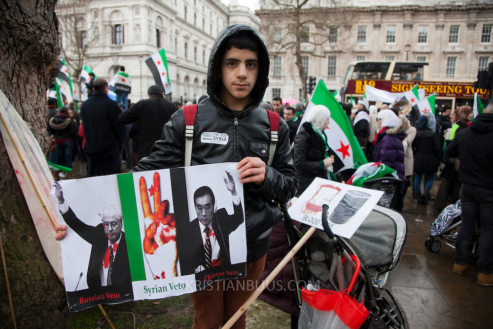 At an Anti-Assad Syrian demonstration held in Whitehall, Central London. The demonstration was called by the Syrian Community in the UK under the head lines; Syrians are being killed in a genocide and the world is watching. Several hundreds gathered opposite Downing Street 10 calling for Syrians to unite and the world to intervene.