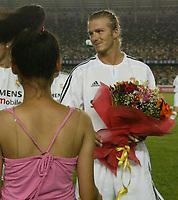 Fotball<br /> Real Madrid i Kina<br /> David Beckham gjør sin debut for Real Madrid<br /> Foto: Digitalsport<br /> <br /> China Dragon XI v Real Madrid at the Workers Stadium, Beijing, China. 02/08/2003.<br />David Beckham on his Real Madrid debut.