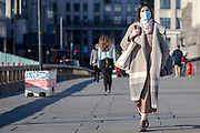 Many people (mainly Asians) are seen wearing face protective masks against Coronavirus pandemic that spread across the world within 12 weeks. This is a picture taken on Sunday, March 22, 2020. <br /> For most people, the new coronavirus causes only mild or moderate symptoms, such as fever and cough. For some, especially older adults and people with existing health problems, it can cause more severe illness, including pneumonia.  (Photo/Vudi Xhymshiti)