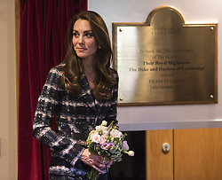 The Duchess of Cambridge unveils a plaque during a visit to Francis House hospice in Manchester.