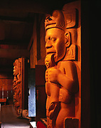 """Gonakedeit Housepost and Shaman ('Ixt"""" Gaas) Housepost by doorway of Chief Shakes Tribal House.  Steve Brown, Wayne Price and Will Bulkhardt carved these replication posts in 1985.  Wrangell, Alaska."""
