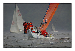 Yachting- The first days racing  of the Bell Lawrie Scottish series 2003 at Gourock.  The wet start looks set to last for the overnight race to Tarbert...Last years winner Hamish McKay and crew in their chartered Class one Kerr 11.3 Blue Bell of Kip heading upwind...Pics Marc Turner / PFM