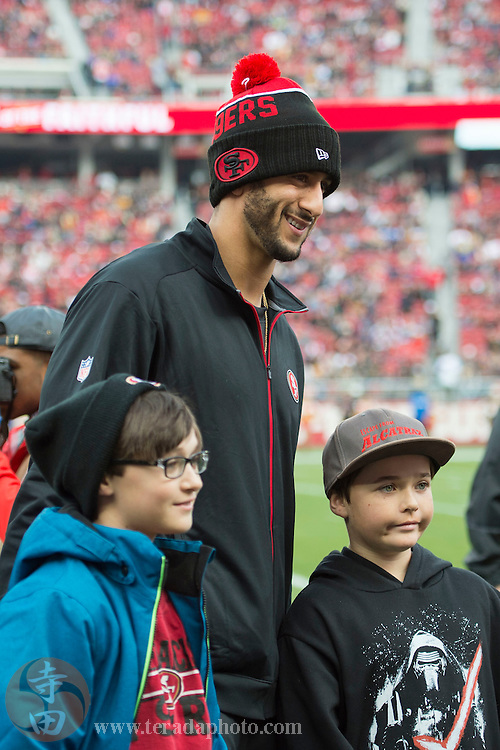January 3, 2016; Santa Clara, CA, USA; San Francisco 49ers quarterback Colin Kaepernick (7) poses for a photo with fans against the St. Louis Rams before the game at Levi's Stadium.