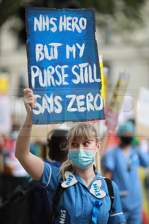 © Licensed to London News Pictures. 08/08/2020. London, UK. NHS workers take part in a demonstration to call for pay increases after missing out on the latest round of public sector pay rises. Photo credit: Rob Pinney/LNP