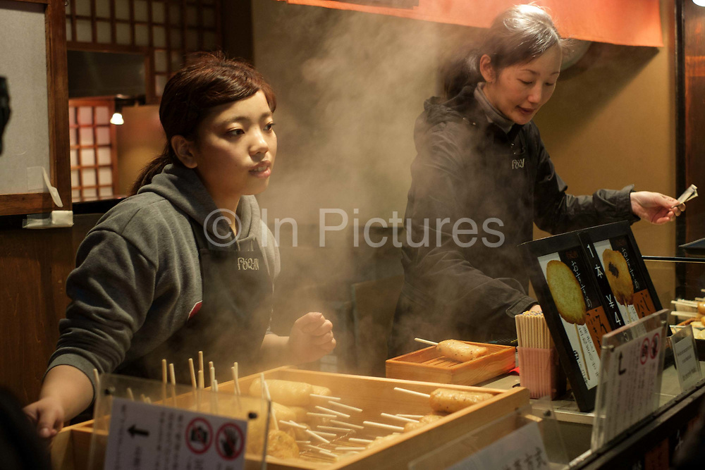 Street food on sale at Nishiki market. Largest traditional food market in Kyoto.Kyoto, Japan.