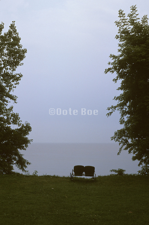 Empty chairs looking out over a lake