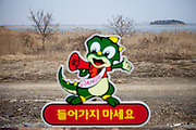 Warning sign at the Haenam Uhangri Dinosaur Museum located on Jindo Island. Heanam Uhang-ri is a place first designated as a natural monument (No.394) among numerous natural properties in Korea. It is full of rare remains of dinosaurs, including world largest footprints of the Pterosur. Jindo Island is the 3rd biggest island in South Korea located in the South-West end of the country.