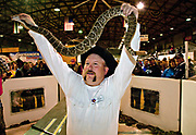 Terry Armstrong, a Jaycee volunteer snake handler holds up a giant western diamondback rattlesnake for the crowd during the 51st Annual Sweetwater Texas Rattlesnake Round-Up March 14, 2009 in Sweetwater, Texas. During the three-day event approximately 240,000 pounds of rattlesnake will be collected, milked and served to support charity.