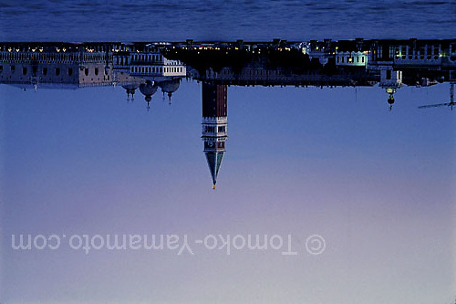 The lights along the Molo facing the San Marco Basin come on as the sun sets and the sky takes on soft hues of blue and pink. Photo of Venice, Italy by Tomoko Yamamoto