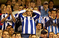 Photo. Jed Wee.<br /> Sunderland v Huddersfield Town, Carling Cup 2nd Round, Stadium of Light, Sunderland. 23/09/2003.<br /> Huddersfield fans will their team on as they defend a 2-1 advantage at half time.
