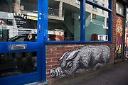 Street art by Roa and various artists on Brick Lane, in Shoreditch, East London, United Kingdom. Street art in the East End of London is an ever changing visual enigma, as the artworks constantly change, as councils clean some walls or new works go up in place of others. While some consider this vandalism or graffiti, these artworks are very popular among local people and visitors alike, as a sense of poignancy remains in the work, many of which have subtle messages.