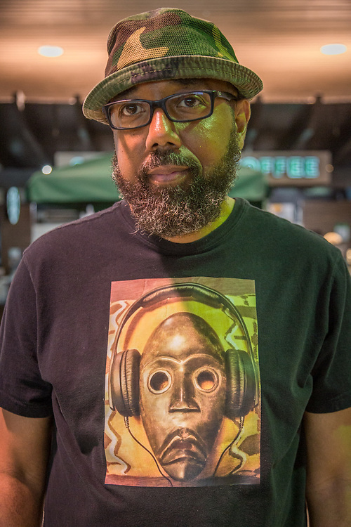 """""""I've been a marriage and family therapist for 20 years...it's my life's work.""""  -Gerald Chambers waits for his flight at Oakland International Airport."""