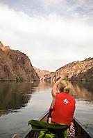 Canoer navigates the Colorado River through The Black Canyon, Nevada.
