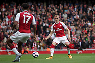Rob Holding Of Arsenal passes to Alex Iwobi of Arsenal. <br /> Premier league match, Arsenal v Brighton & Hove Albion at the Emirates Stadium in London on Sunday 1st October 2017. pic by Kieran Clarke, Andrew Orchard sports photography.