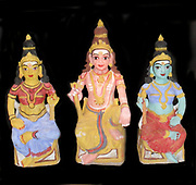 The Hindu Trimurti or Trinity represented in small statuette figures, from early 20th Century India. (Left) Brahma, represented as Saraswati (his consort); (Centre) Shiva and (right) Vishnu, represented as Lakshmi (his consort). In Hinduism, there is a concept that the cosmic functions of creation, maintenance, and destruction are personified by the forms of Brahma Vishnu and Shiva respectively.