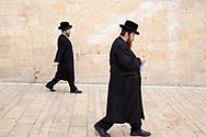 Jewish men walking towards the Western Wall in Jerusalem