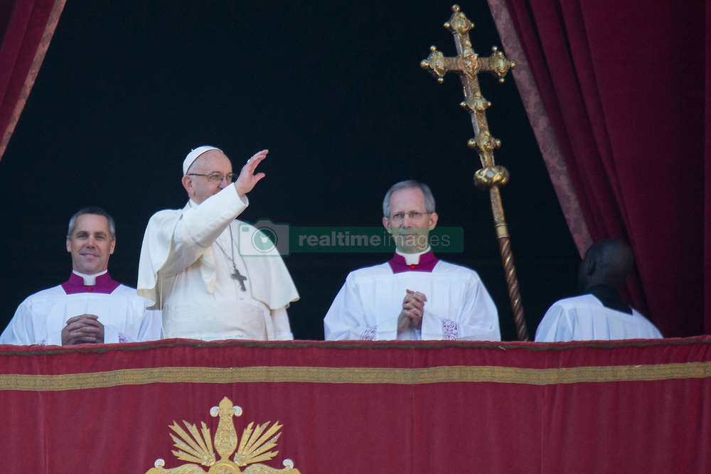 """Pope Francis delivers his traditional Christmas Message and """"Urbi et Orbi"""" Blessing from the balcony of St Peter's basilica at Saint Peter's Square in Vatican City on December 25, 2017. 25 Dec 2017 Pictured: Pope Francis waves from the balcony of St Peter's basilica during the traditional """"Urbi et Orbi"""" Christmas Blessing at Saint Peter's Square in Vatican City on December 25, 2017. Photo credit: Stefano Costantino / MEGA TheMegaAgency.com +1 888 505 6342"""