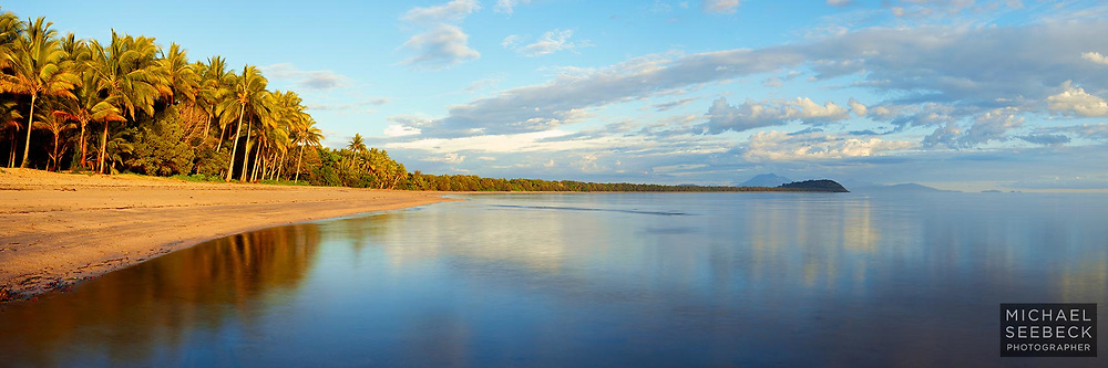 A beautiful still morning at Four Mile Beach, Port Douglas, is captured in this panoramic photograph.<br /> <br /> Code: HAQT0027<br /> <br /> Limited Edition Print