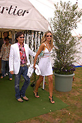 Andy Wong and Lady Victoria Hervey. Cartier International Day at Guards Polo Club, Windsor Great Park. July 24, 2005. ONE TIME USE ONLY - DO NOT ARCHIVE  © Copyright Photograph by Dafydd Jones 66 Stockwell Park Rd. London SW9 0DA Tel 020 7733 0108 www.dafjones.com