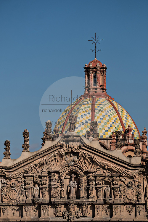 The tiled dome on the Baroque Churrigueresque style Iglesia del Carmen church and convent in the historic center on the Plaza del Carmen in the state capital of San Luis Potosi, Mexico.