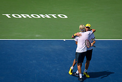 August 12, 2018 - Toronto, ON, U.S. - TORONTO, ON - AUGUST 12:  Henri Kontinen (FIN) and. John Peers (AUS) celebrate after winning the Rogers Cup Doubles tennis tournament Final on August 12, 2018, at Aviva Centre in Toronto, ON, Canada. (Photograph by Julian Avram/Icon Sportswire) (Credit Image: © Julian Avram/Icon SMI via ZUMA Press)